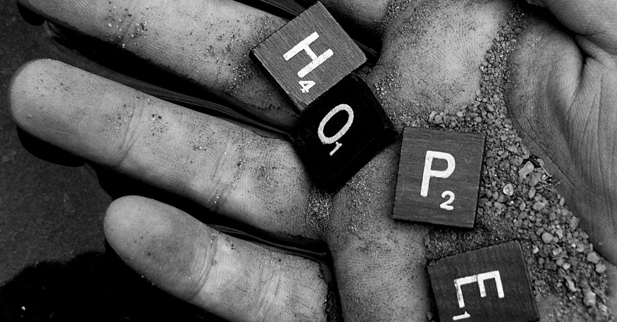 """Hand holding the word """"Hope"""""""