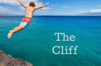 Guy jumping off cliff into ocean